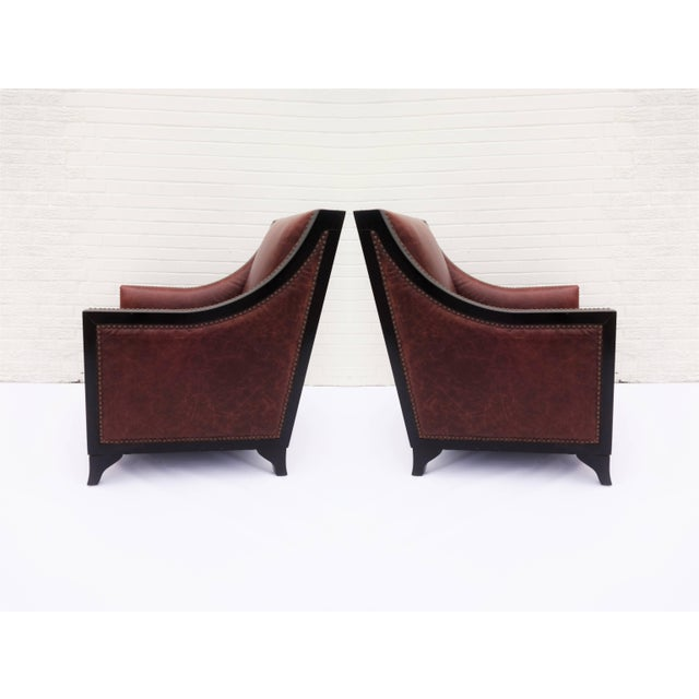 Pair of French Art Deco club chairs in rich cognac colored leather. Nice patina, all the hallmarks of natural leather...
