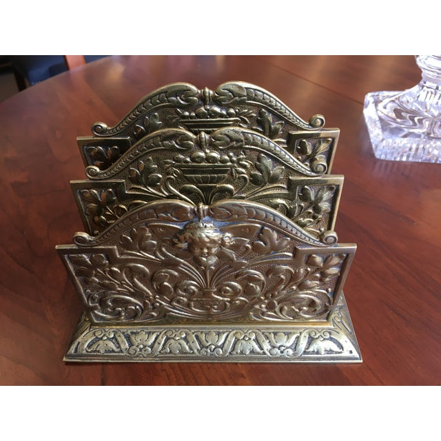 Antique brass three slot letter holder with cherub on front. Made in the 1910s.
