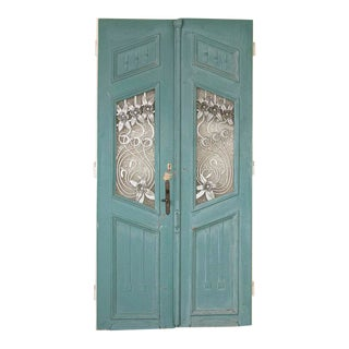 Antique Blue Painted Doors With Decorative Iron Flowers - a Pair For Sale