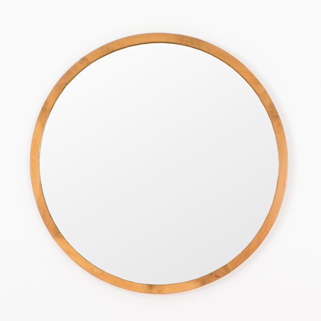 Gilbert Rohde for Herman Miller. Simple round wall mirror with maple frame.