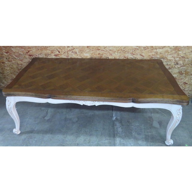"Country French refractory dining table with cherry parquetry top cream painted carved base , a 24"" leave extends from..."
