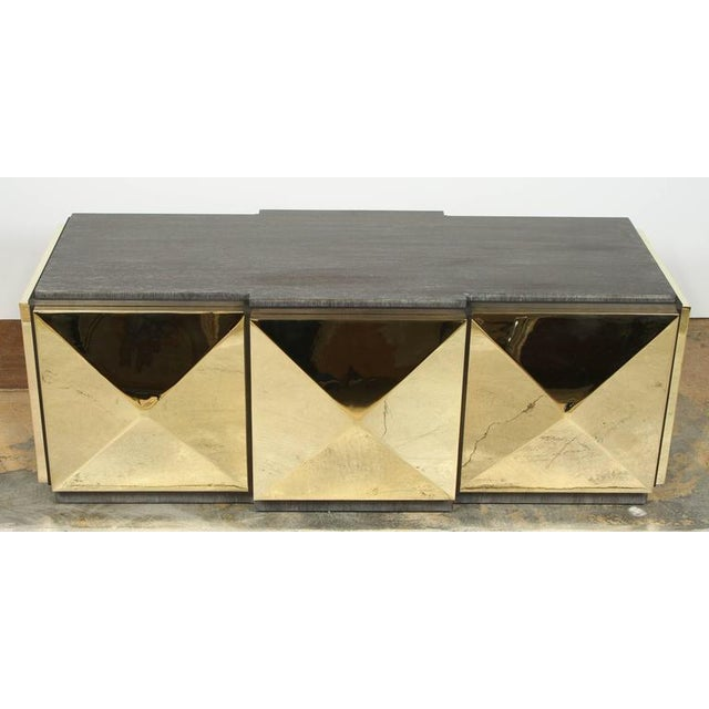 Paul Marra brass tile cocktail table. Polish unlacquered brass, walnut veneer with a medium antique walnut finish. The...