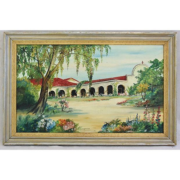 Midcentury oil painting on canvas depicting the California mission of San Juan Capistrano. Displayed in a period wood...