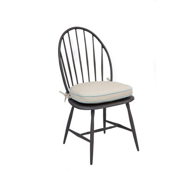 It's aluminum, not wood, which means this classic chair can be used outdoors.