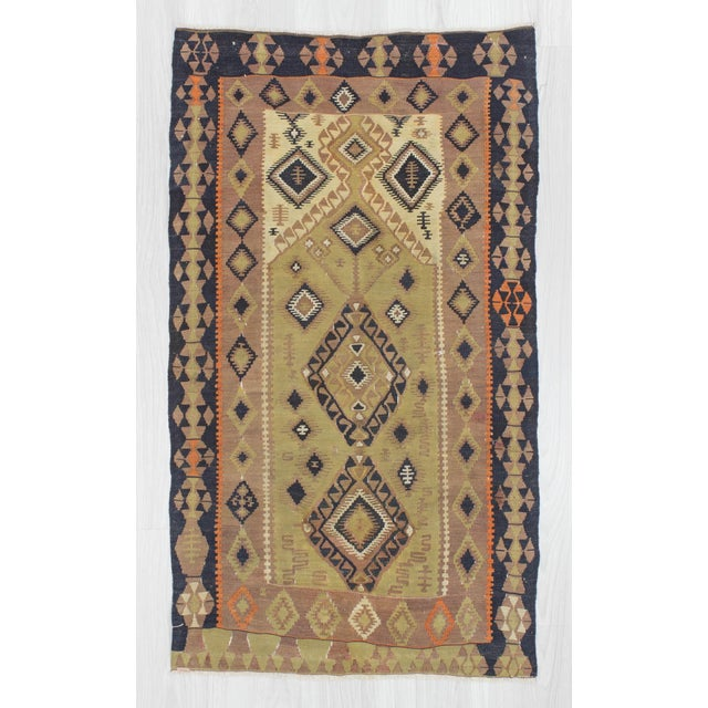 Handwoven vintage kilim from Malatya region of Turkey. In very good condition. Approximately 70-80 years old.