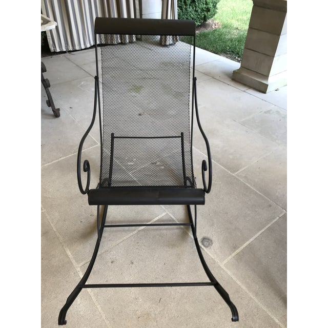 French Iron Rocking Chair with Mesh Sling Seat. This chair is like a piece of sculpture but also really fun to sit in. The...
