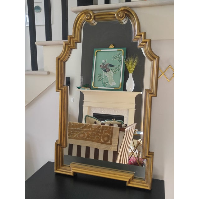 An enduring classic, this Queen Anne hollywood regency mirror is a favorite look of many decorators (Miles Redd comes to...