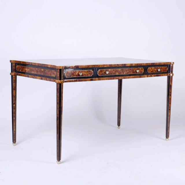 Chic modern three-drawer desk or writing table covered in a mosaic of pen shell in variegated colors and bordered with...