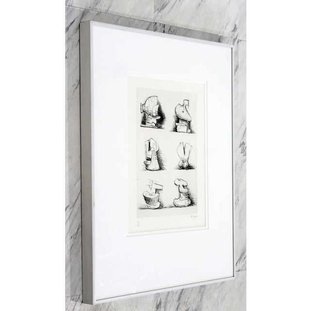 For your consideration is a stunning, framed print Six Sculptures Motive by Henry Moore, signed and numbered 182/200. In...