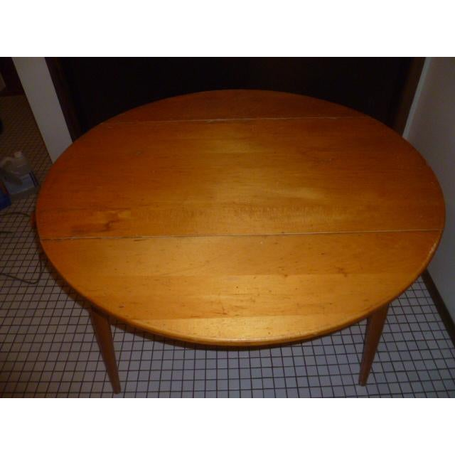 """Clean blonde wood Paul McCobb or style round Planner maple drop leaf table 42"""" This has the original finish, no refinish...."""