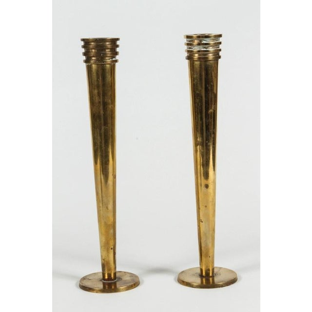 A pair of Art Deco style Hudson Rissman brass candlesticks. Have some discoloration and markings.