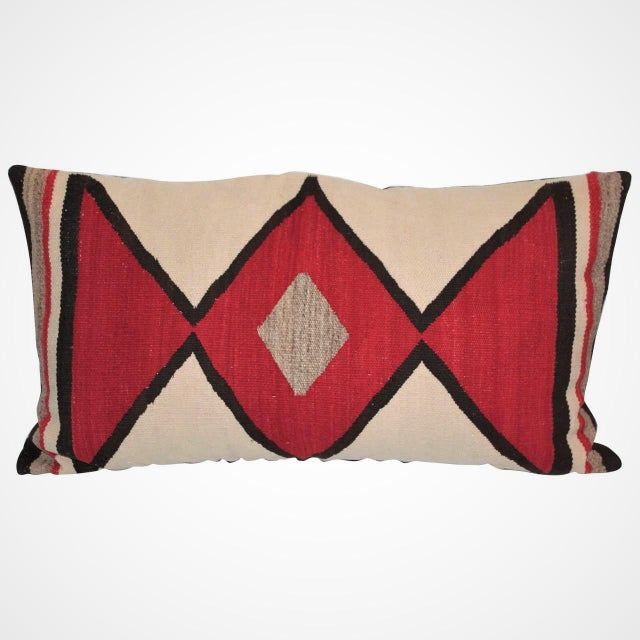 Early geometric Navajo weaving bolster pillow. This most unusual pattern and the backing is in black cotton linen.