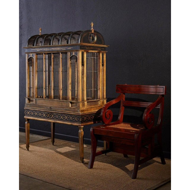 Distinctive English Regency style metamorphic library step ladder chair constructed from mahogany. Features a large...