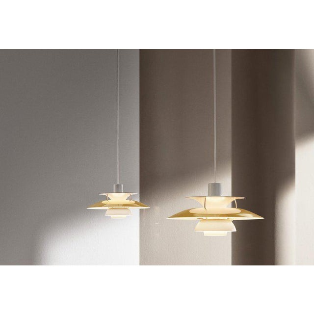 *NOTE: 2-3 WEEK LEAD TIME* Poul Henningsen PH5 mini brass pendant for Louis Poulsen. Poul Henningsen introduced his iconic...