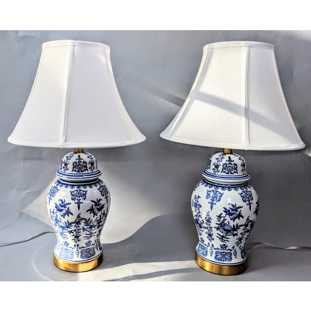 These blue and white porcelain lamps (sold individually) are painted with a modern take on a traditional Chinoiserie...