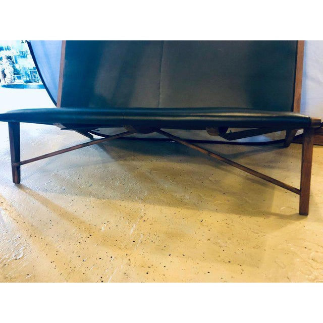 Mid Century Modern Settee or Loveseat in Black Vinyl. Having sleek and stylish lines this X side shaped sofa is strong and...