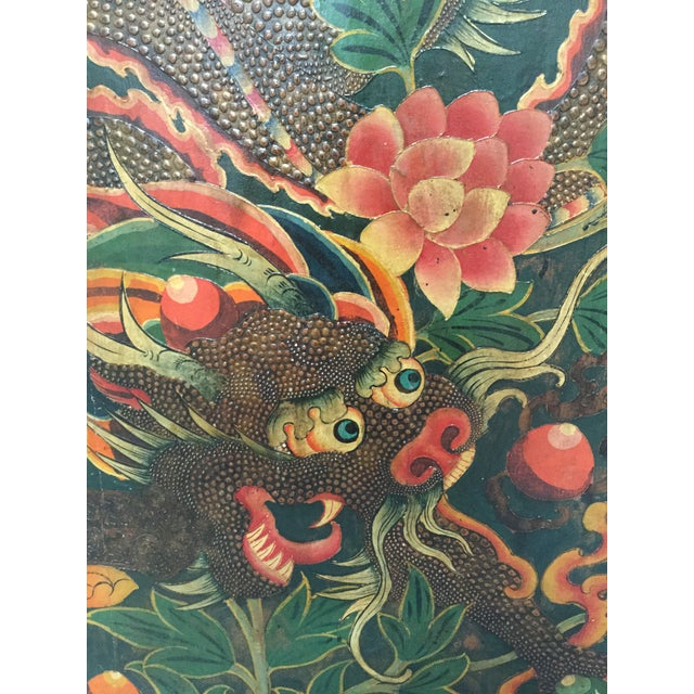 Beautifully playful Tibetan dragon and other auspicious symbols are painted on this antique door from a monastery in...