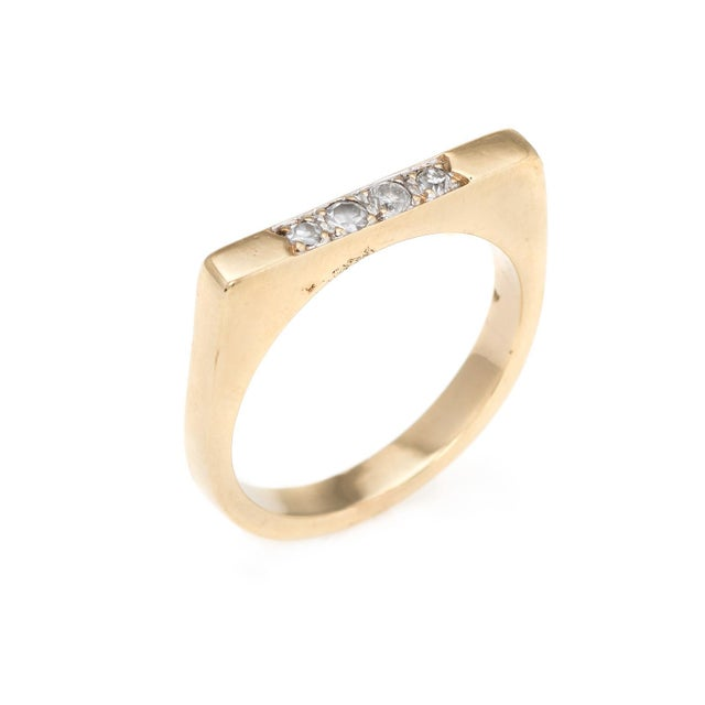 Finely detailed set of 2 diamond stacking rings (circa 1970s to 1980s), crafted in 14 karat yellow gold. 4 diamonds are...