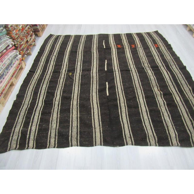 Handwoven vintage striped kilim rug from Afyon region of Turkey. In very good condition. Approximately 45-55 years old