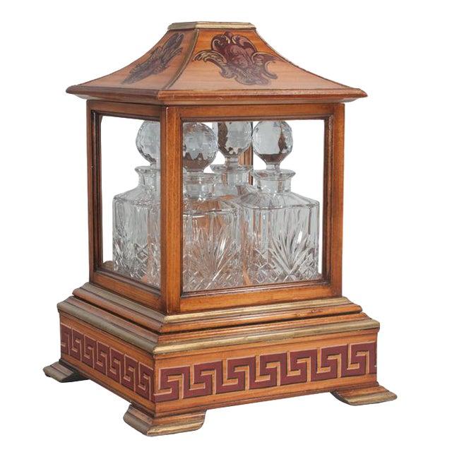 Early 20th Century Georgian Style Walnut Tantalus Set - Set of 4 For Sale