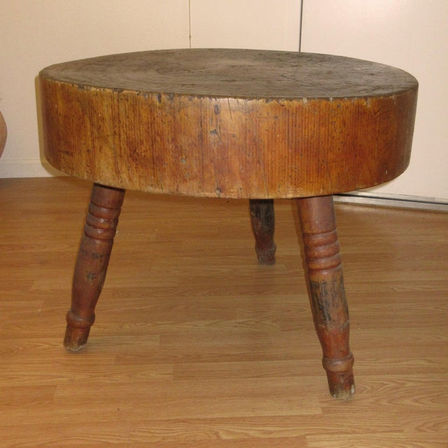 Early 19th-century antique American butcher block table. Sectioned from a 7.5-inch thick slab of a tree trunk and...