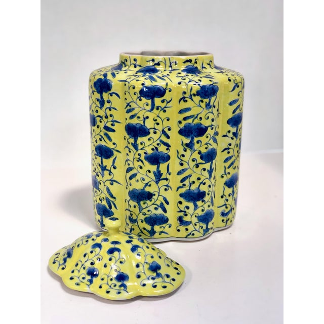 Gorgeous hand painted Chinese urn with lid in yellow and Blue. This vase is stunning in these vibrant colors. The yellow...
