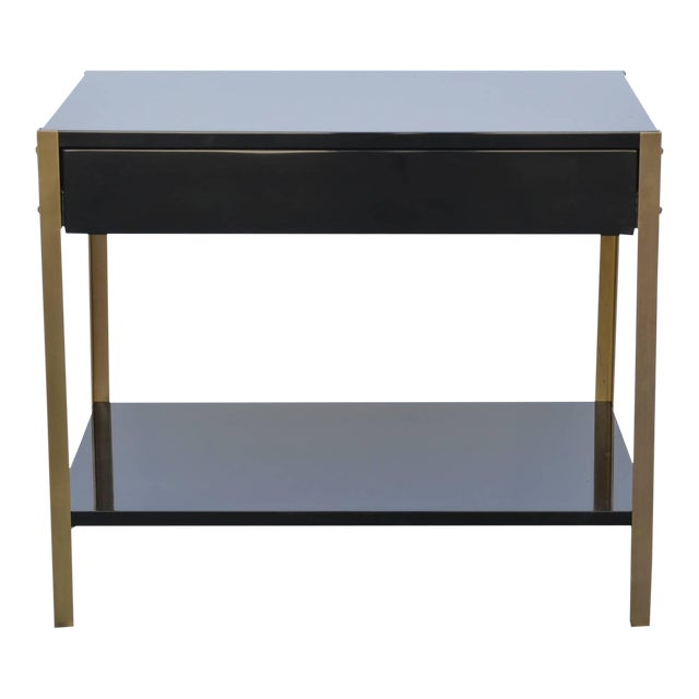 Pair of chic black lacquer nightstands in the style of Maison Jansen. Hand polished lacquer surfaces with brushed solid...