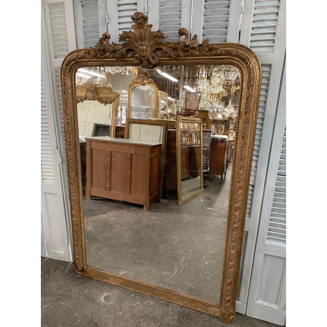Beautiful antique Louis Philippe period mirror with original gold leaf and original glass. The frame maintains a tall,...