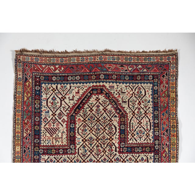 Antique prayer rug. Natural dyes, even pile, restoration to ends. Red, yellow, green, blues, ivory, gold, brown.
