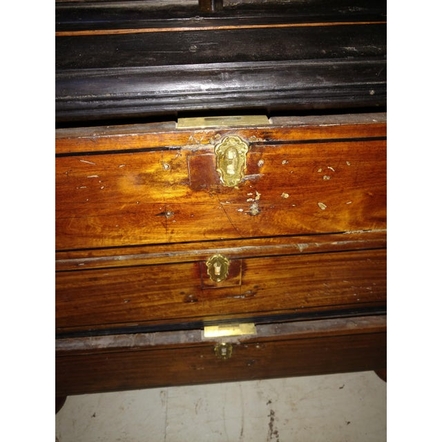 Antique Anglo Indian cupboard ebony and satinwood. This is in 2 pieces. A cupboard with a shelf and three drawers on...