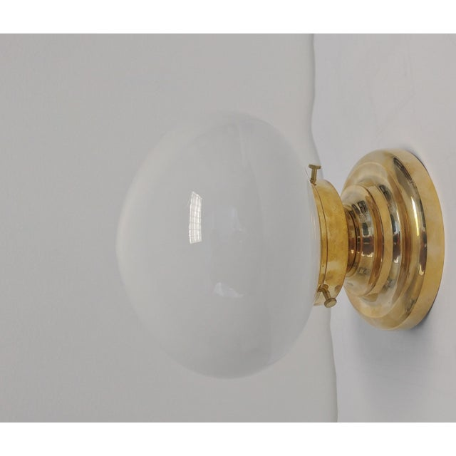 Urban Archaeology Yacht Light flush mount or wall installation in unlacquered polished brass with opal glass globe....