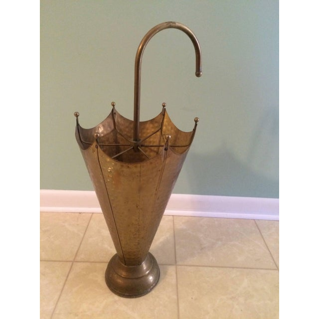 Keep the water off the floor and your guests talking about this wonderful hammered brass umbrella Stand, French, circa...