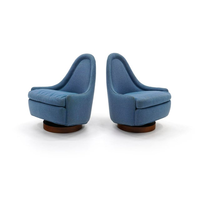 Pair of small/petite rocking swivel chairs designed by Milo Baughman for Thayer Coggin. Both retain the original Thayer...