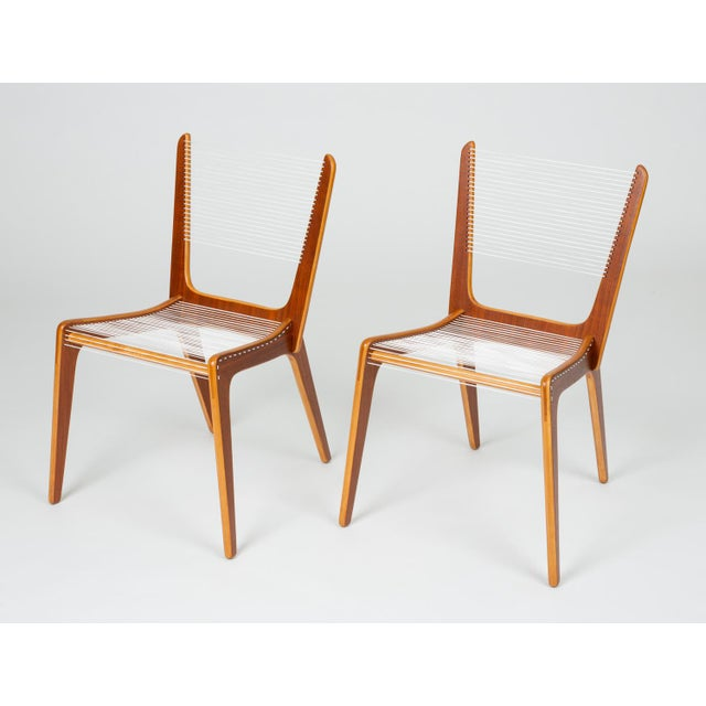 A pair of delicate accent chair by French Canadian designer Jacques Guillon. Designed in 1953, nearly transparent design...
