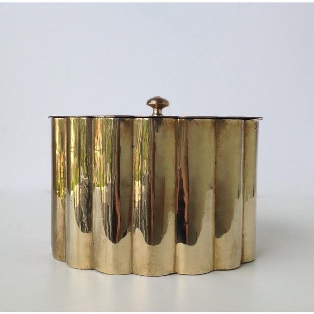 1960s; Mid-Century, solid brass, barrel fluted, lidded tea caddy or biscuit contianer. One can also utilize this container...