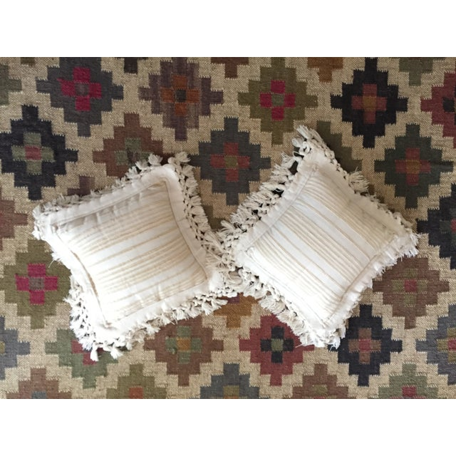 Vintage pair of fringed cream pillows, woven in India. These are complete pillows, with synthetic inner filling. The tag...