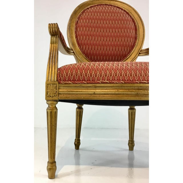 Elegant French Style Port 68 Avery Chair, aged gold finish frame with tapered legs and medallions, and a tone on tone...