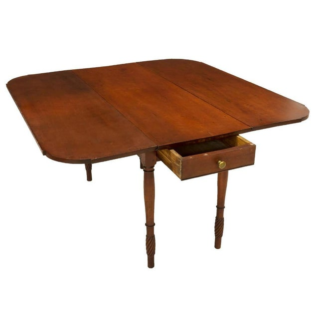 Classic American Federal style Pembroke table made of solid Cherrywood. From Kentucky, this dropleaf table consists of a...