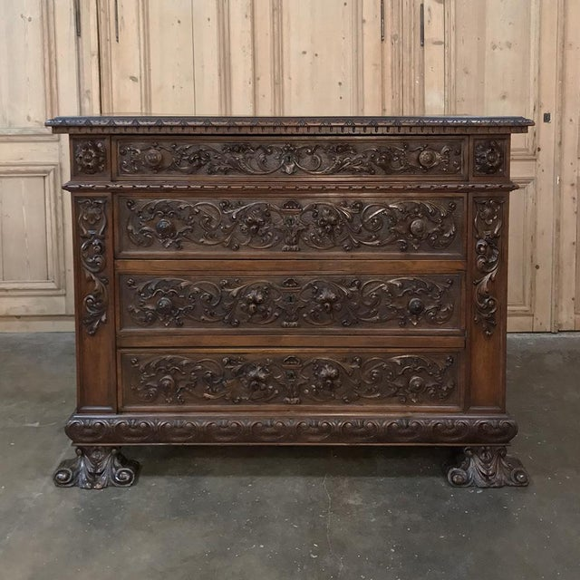 19th Century Italian Renaissance Walnut Commode represent the essence of the style with elaborately carved bas relief and...