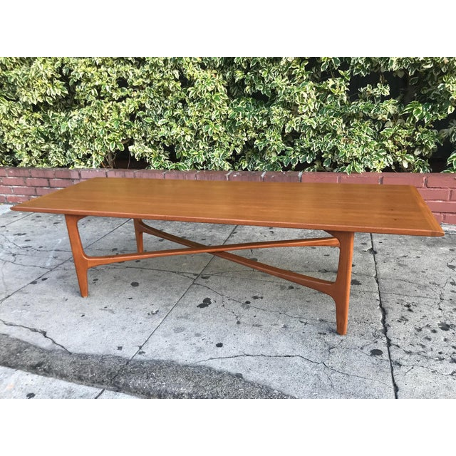Stunning mid-century modern rectangular coffee table by Dux. Made in Denmark and fabricated in teakwood. Features the X...