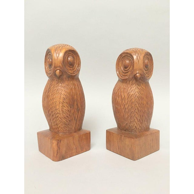 Pair of heavy wood hand carved owl bookends, each slightly different in size, shape and detail. Each bookend measures...