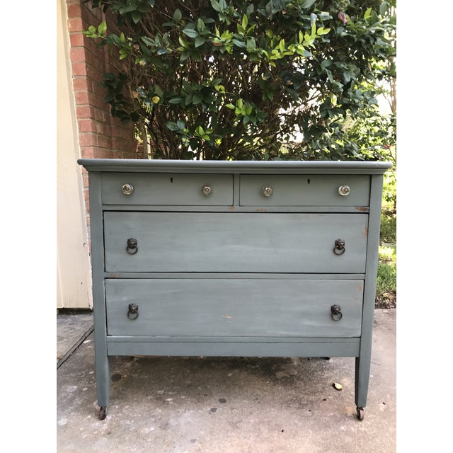 Solid oak antique dresser with 3 dovetail jointed drawers. Still on original castors. Awesome chippy milk paint finish!...