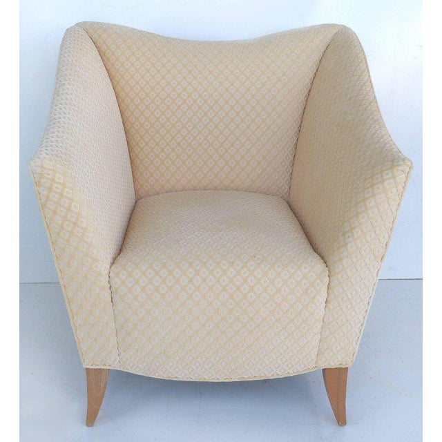 Offered for sale is a pair of plush, upholstered, sculptural club chairs. The upholstery is a cut velvet in an ivory...