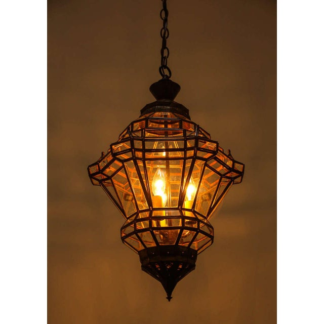 Smaller version of our elegant Granada Moroccan pendant, diamond shape clear glass lantern with bronze metal finish. Has a...