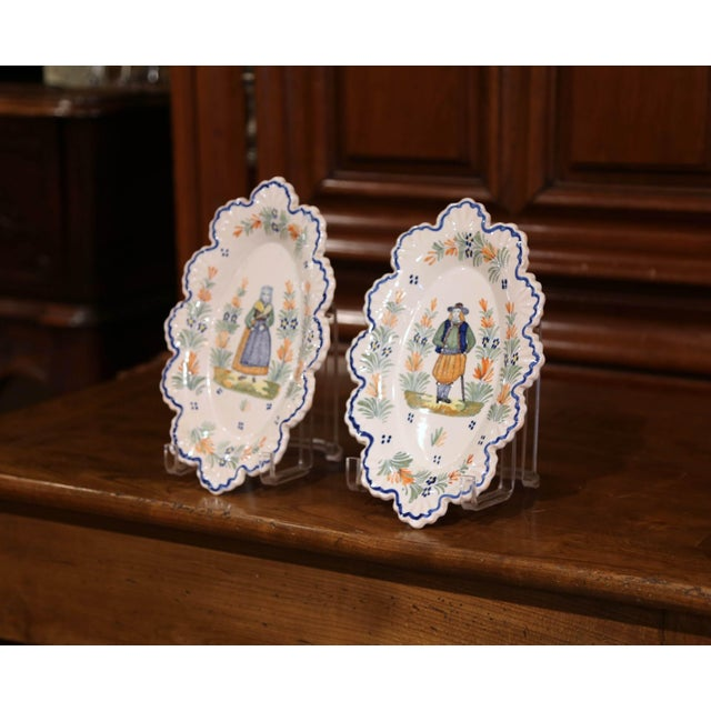 Decorate a kitchen wall or a shelf with this pair of antique decorative plates. Crafted in Brittany circa 1890, each...
