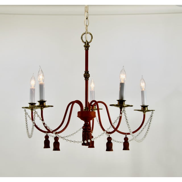 "Vintage 5 arm Red Painted iron and brass chandelier with a garland of crystal beads and tassels. 23 1/2"" diameter, 21 1/2""..."