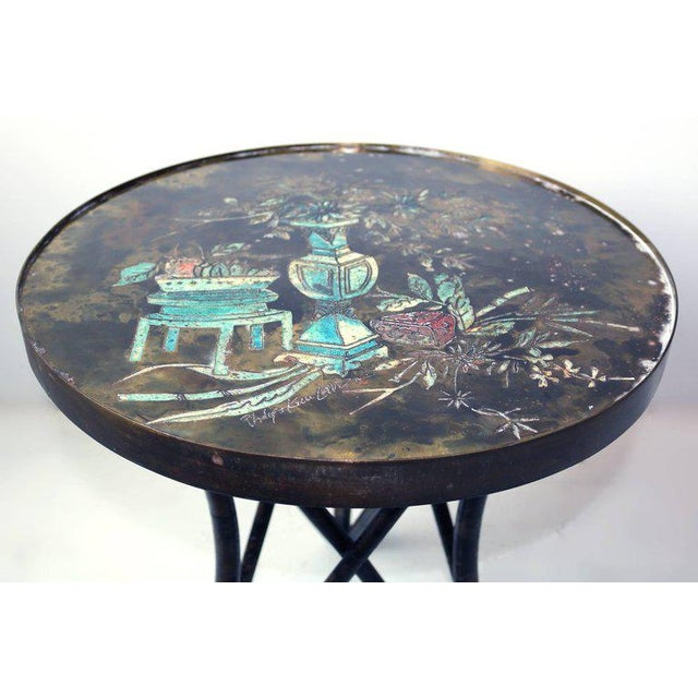 Unusual Philip and Kelvin LaVerne circular side table with a colorful still-life motif. Acid-etched bronze top with...