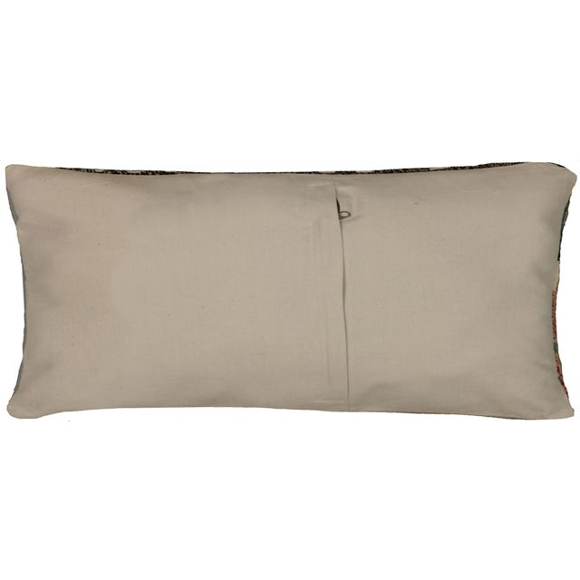 This pillow is made with a vintage handwoven Turkish cicim (jijim) rug fragment. It has a cotton back and a zipper...