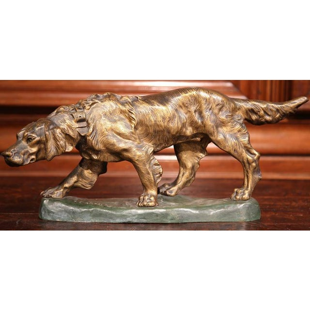 This beautifully executed, antique bronze figure was sculpted in France, circa 1900. The sculpture depicts a hunting dog...