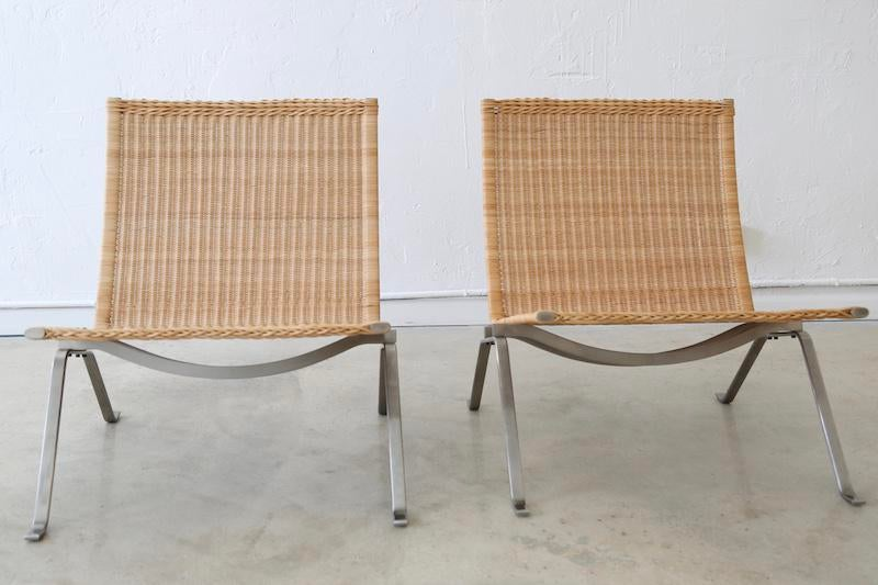 A Beautiful Pair Of Cane PK 22 Lounge Chairs Designed By Poul Kjaerholm In  1957.